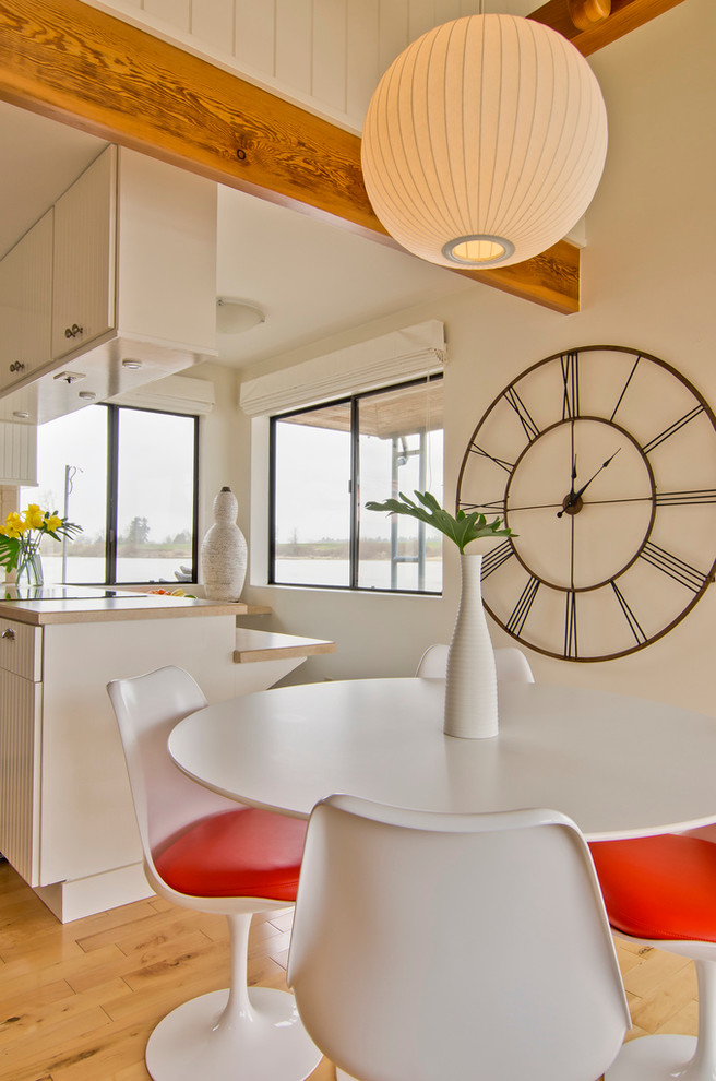 oversized wall clock Dining Room Modern with beige countertop beige wall bubble pendant exposed wood beams globe pendant iron