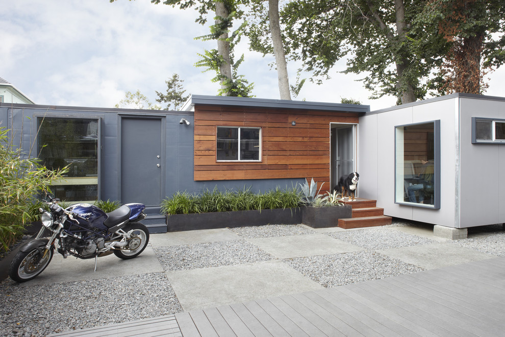 oxo pop containers Exterior Contemporary with concrete patio concrete pavers flat roof flowerbeds gravel grey grey exterior mixed