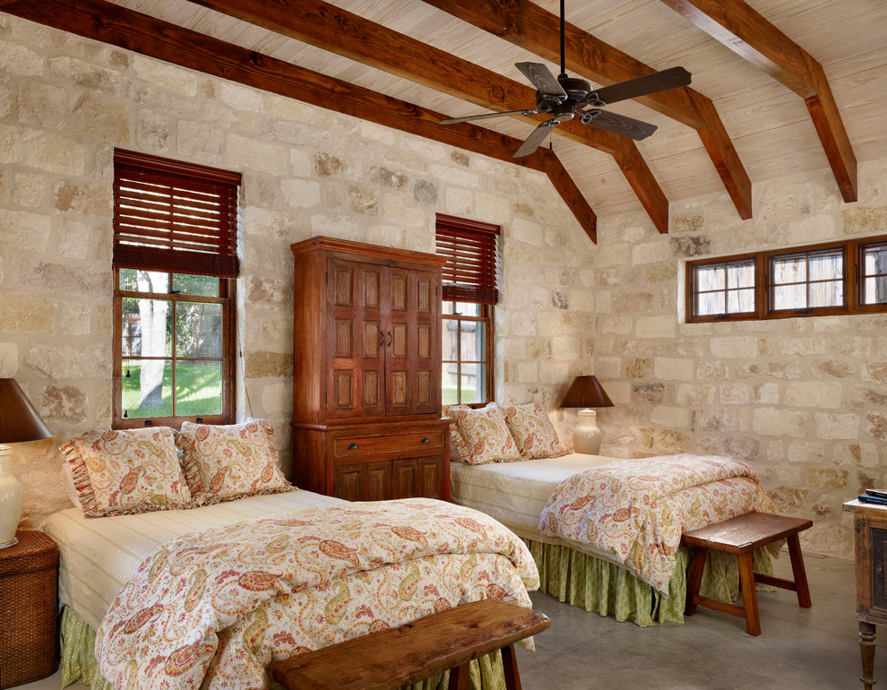 Paisley Bedding Bedroom Farmhouse with Armoire Bedside Table Ceiling Fan Charming Exposed Beams Foot of the Bed