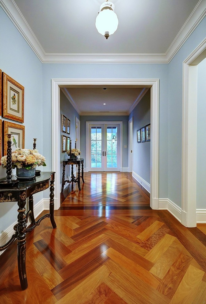 Parquet Flooring Hall Traditional with Antique Artwork Blue Console Table Double Doors French Doors Gold Frames Hallway