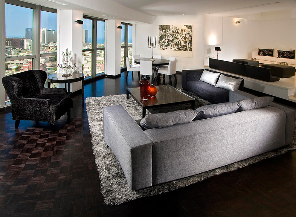 Parquet Flooring Living Room Contemporary with Black Chair Chrome City View Gray Rug Gray Sofa Large Windows Open