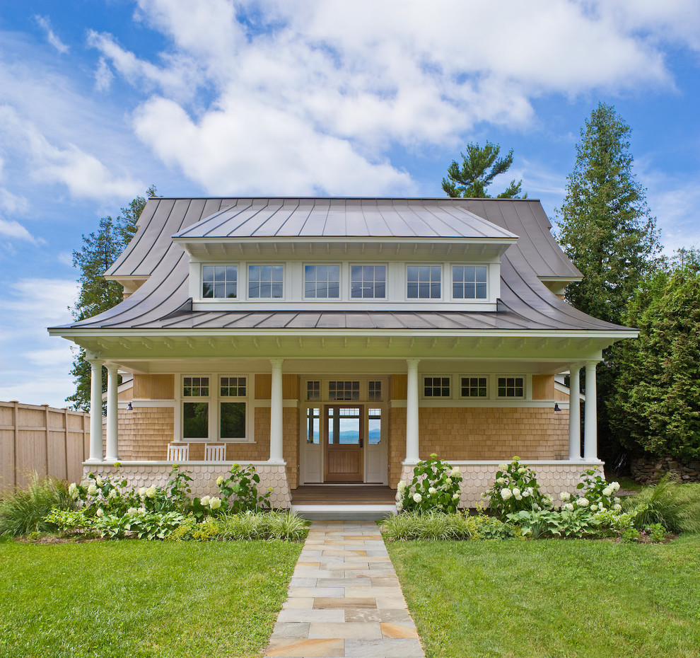 Patio Rocking Chairs Exterior Beach with Awning Windows Cedar Shakes Dormer Entry Hydrangea Landscape Lawn Metal Roof Muntins