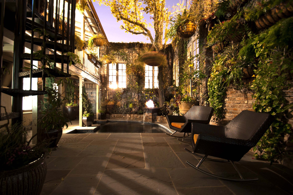 Patio Rocking Chairs Landscape Contemporary with Brick Wall Climbing Vines Courtyard Enterance Hanging Plants Open Roof Rockers Slate