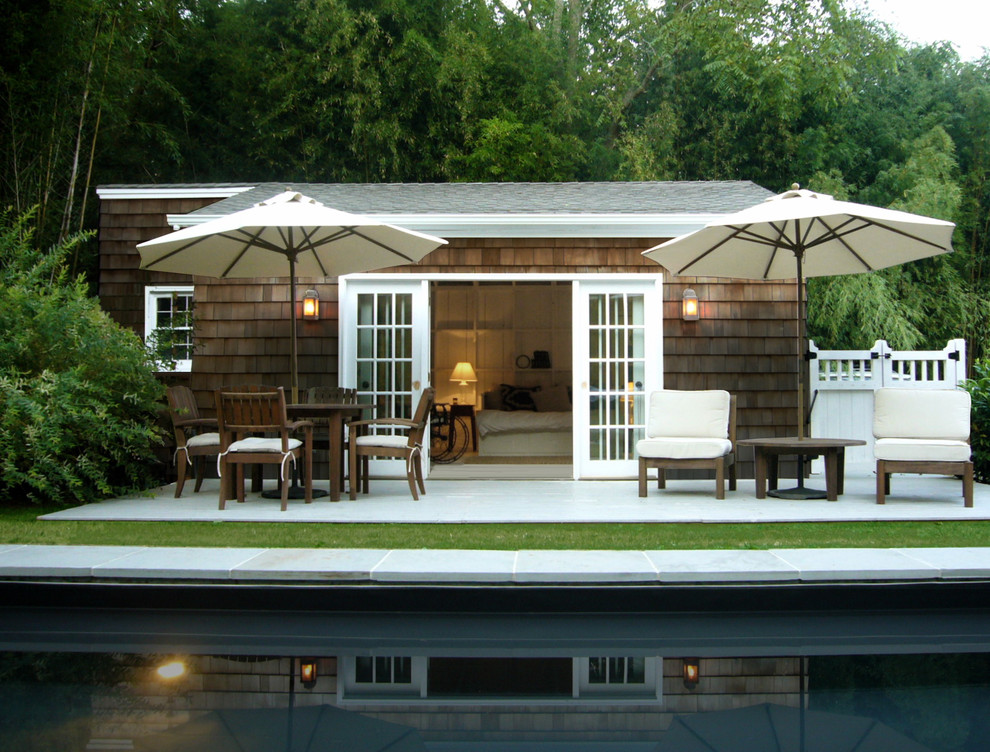 Patio Umbrella Pool Beach with Bamboo Cape Cod Style French Doors Lanterns Outdoor Cushions Outdoor Dining Patio