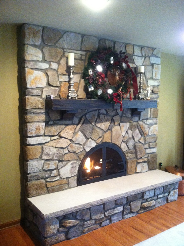 pearl mantels Family Room Rustic with arched fireplace boral Boral Old country field stone Custom Fireplace Door David