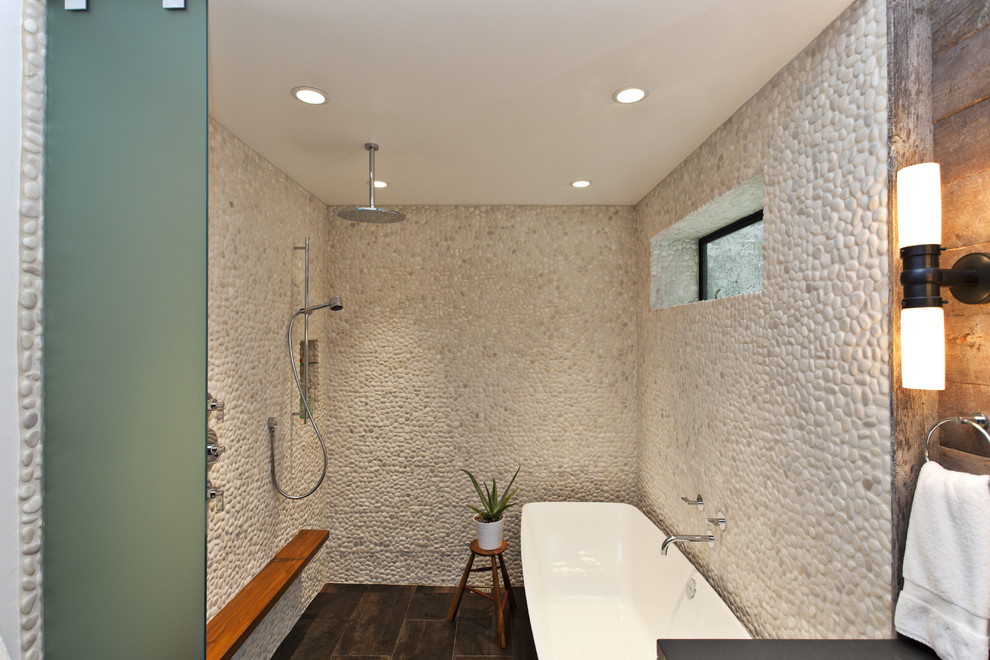 pebble tile Bathroom Contemporary with freestanding tub frosted glass glass wall pebbles rain shower shower ledge stone