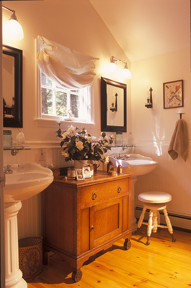Pedestal Sink Bathroom Traditional with Antique Vanity Bathroom Hardware Beadboard Black Frame Mirrors Bright Bathroom Country Home