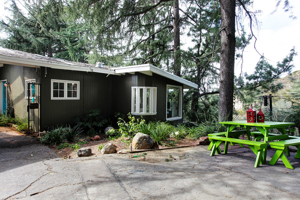 picnic backpack Exterior Transitional with asphalt cottage neon green patio furniture picnic table rustic shed roof white