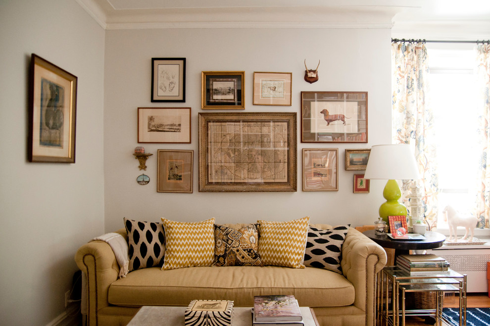 picture collage frames Living Room Eclectic with Artwalls beige sofa beige throw pillow black patterned throw pillow black side