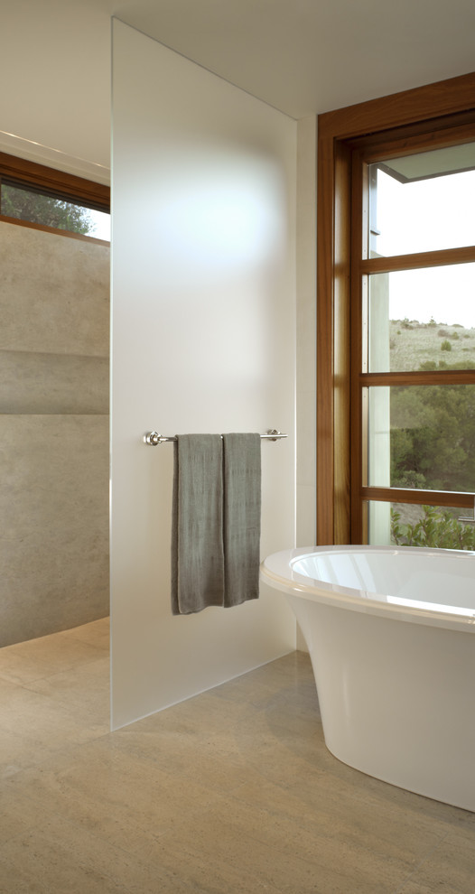 Pilsner Glass Bathroom Modern with Clerestory Freestanding Tub Frosted Glass Minimal Neutral Colors Open Shower Stone Flooring