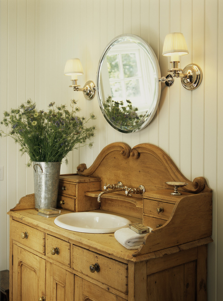 pine dresser Bathroom Beach with bathroom lighting beadboard floral arrangement pivot mirror sconce vintage wall lighting wall