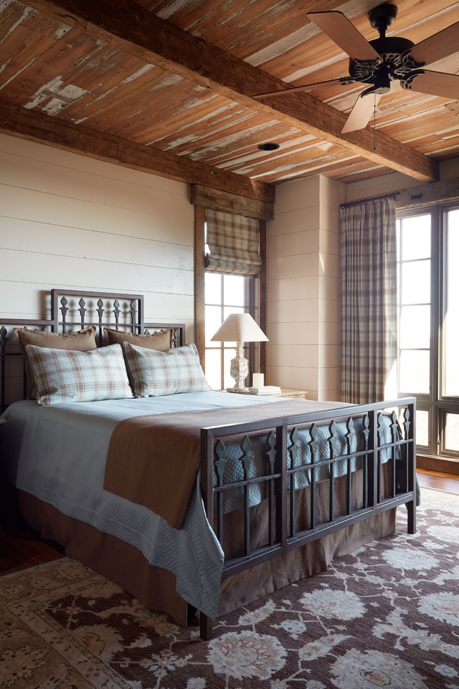 Plaid Bedding Bedroom Eclectic with Beams Blue Brown Floral Rug Iron Bed Large Windows Mountain Home Nightstand