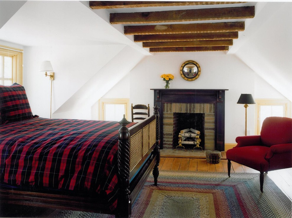 plaid comforter Bedroom Traditional with arm chair black painted mantle carved wood dark stained wood Fireplace ladderback