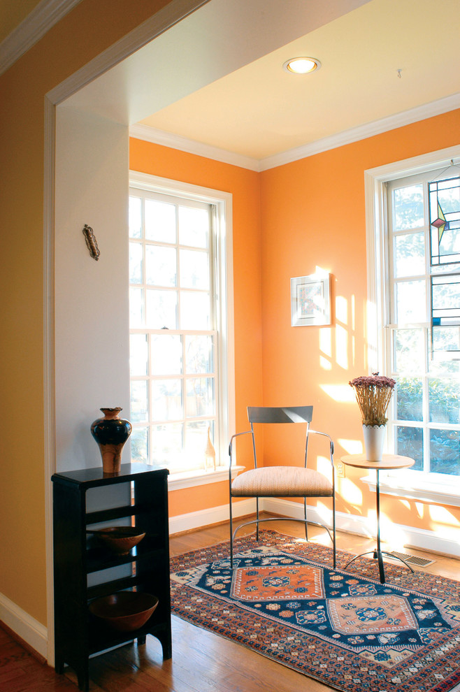 Plantation Chair Family Room Contemporary with Baseboard Ceiling Lighting Crown Molding Metal Chair Nook Orange Wall Oriental Rug1