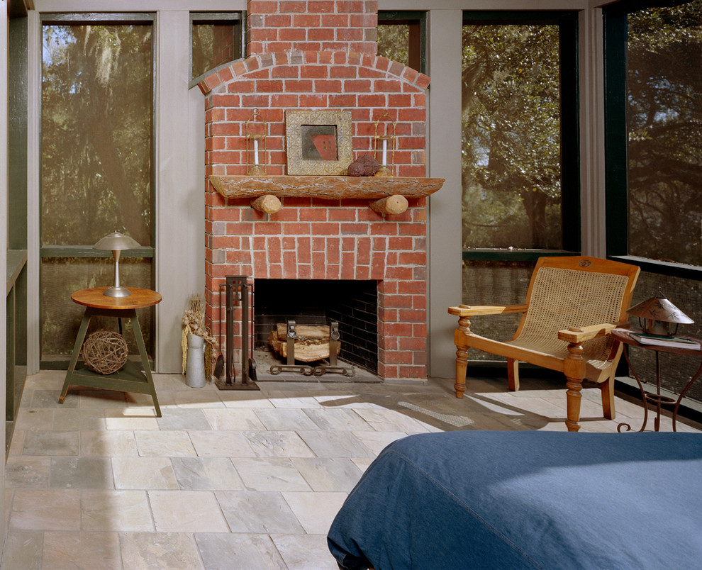plantation chair Porch Rustic with brick fireplace denim duvet Fireplace fireplace accessories fireplace mantel lantern oversized chair