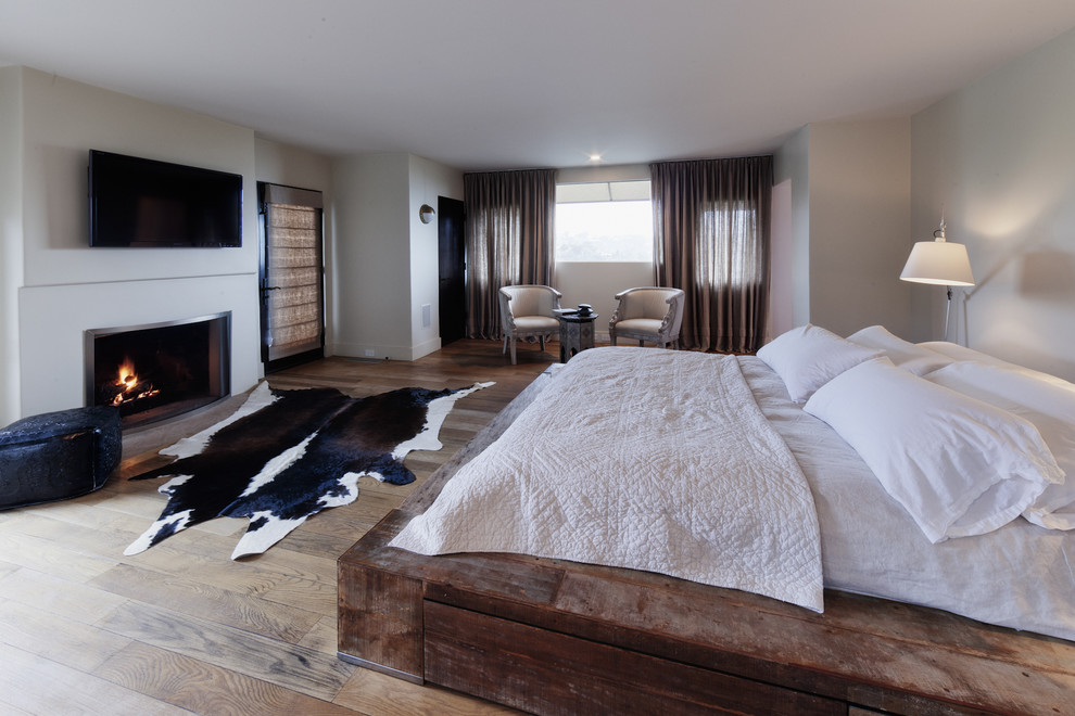 Platform Bed Frame Queen Bedroom Rustic with Cowhide Rug Curtains Drapes Master Bedroom Neutral Colors Platform Bed Reclaimed Wood