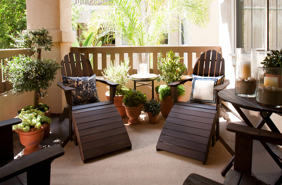 Polywood Adirondack Chairs Porch Beach with Adirondack Chairs Area Rug Container Plants Hurricane Lamps Neutral Colors Outdoor Cushions