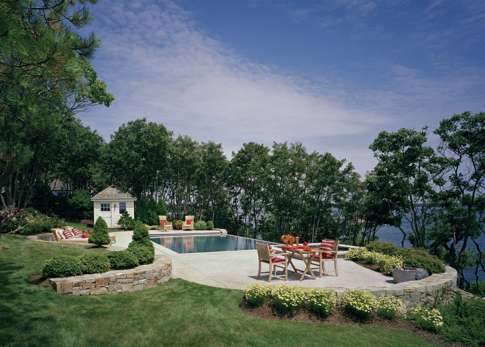 pool rafts Pool Traditional with grass hedge hillside infinity pool lawn outdoor dining patio furniture patio paving