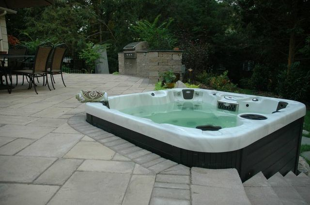 Portable Hot Tub Patio Modern with Abcs Extreme Makeover Hot Tub Above Ground Spas Bullfrog Spas Custom Spas Difference