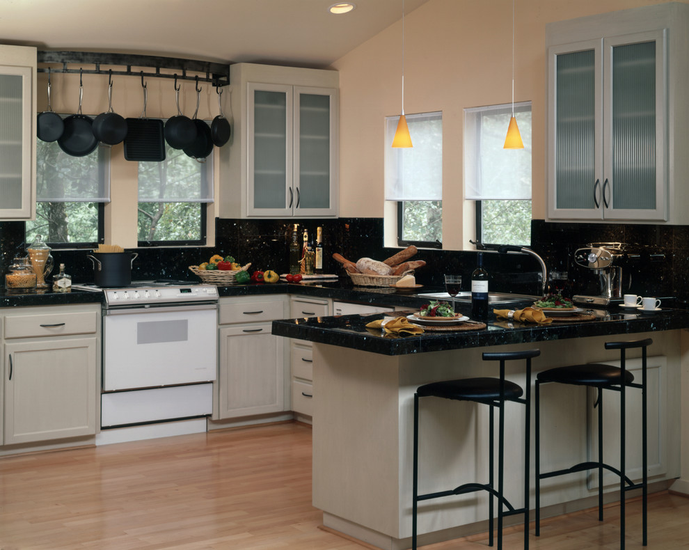 pot and pan rack Kitchen Contemporary with barstools black countertop cast iron pots glass door cabinets kitchen pendant lamp