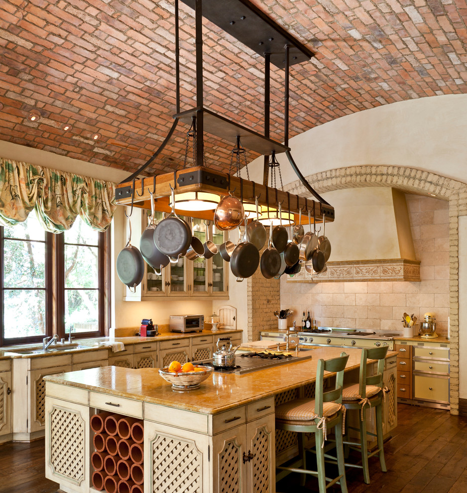 Pot and Pan Rack Kitchen Mediterranean with Arch Barrel Vault Brick Brick Backsplash Cooktop Counter Stools Criss Crossing Glass Panel