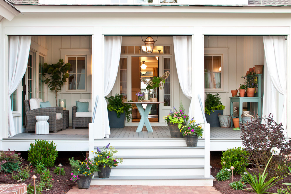 potters bench Porch Traditional with beige outdoor cushions bushes column front porch hanging lantern pillar pink flowers