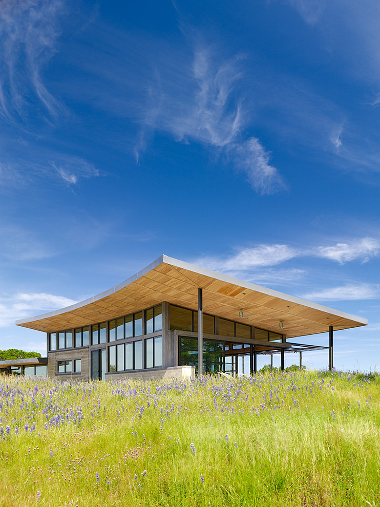prairie view industries Exterior Contemporary with concave roof concrete garden wall hill meadow metal steel posts tall grasses