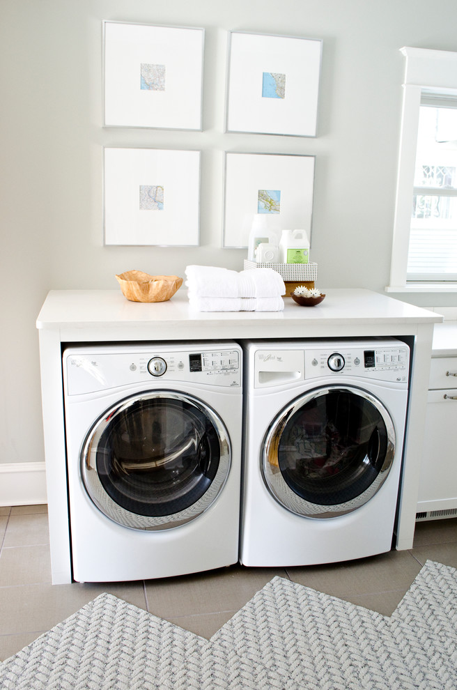 Pressure Washer Attachments Laundry Room Transitional with Aristokraft Cabinet Cabinetry Cabinets Carpet Tiles Dryer Folding Table Front Load Dryer