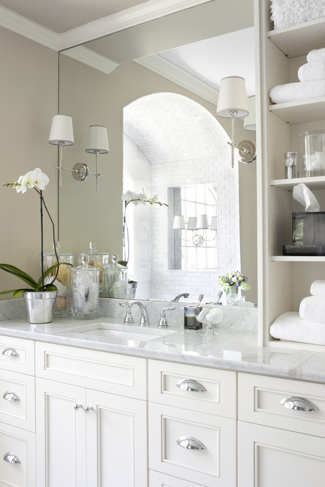 price pfister bathroom faucets Bathroom Traditional with alcove arch Ivory Cabinets large mirror lighting niche marble countertops moulding open