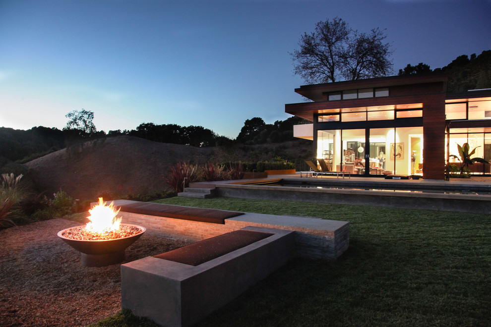 Propane Fire Pit Landscape Modern with Bench Concrete Bench Concrete Patio Exterior Flat Roof Gravel Large Window Pool