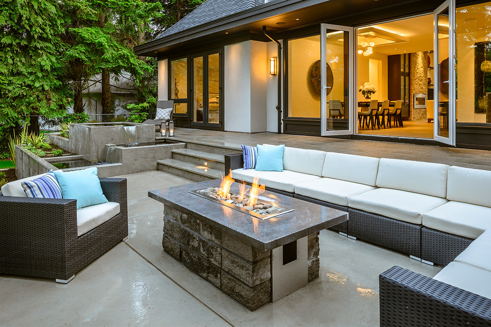 propane fire pit Patio Contemporary with blue concrete patio fire and water features firepit large windows pillows planter