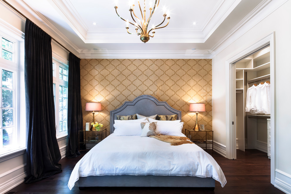 Quatrefoil Bedding Bedroom Contemporary with Accent Wall Black Drapes Brass Closet Dark Floors Glass Nightstand Gold Wallpaper