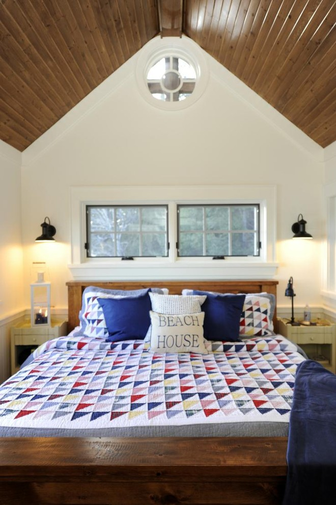 Queen Quilt Size Bedroom Rustic with Bedside Tables Blue Accents Cathedral Ceiling Circle Window Cottage Cozy Muskoka Nautical