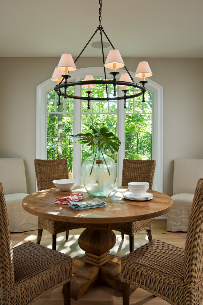 Rattan Dining Chairs Dining Room Traditional with Arched Window Covered Upholstered Chairs Multiple Lampshade Chandelier Natural Wood Table Rattan