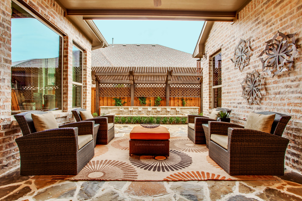 Rattan Ottoman Patio Transitional with Backyard Retreat Beige Outdoor Rug Brick Exterior Brick Siding Covered Patio Metal