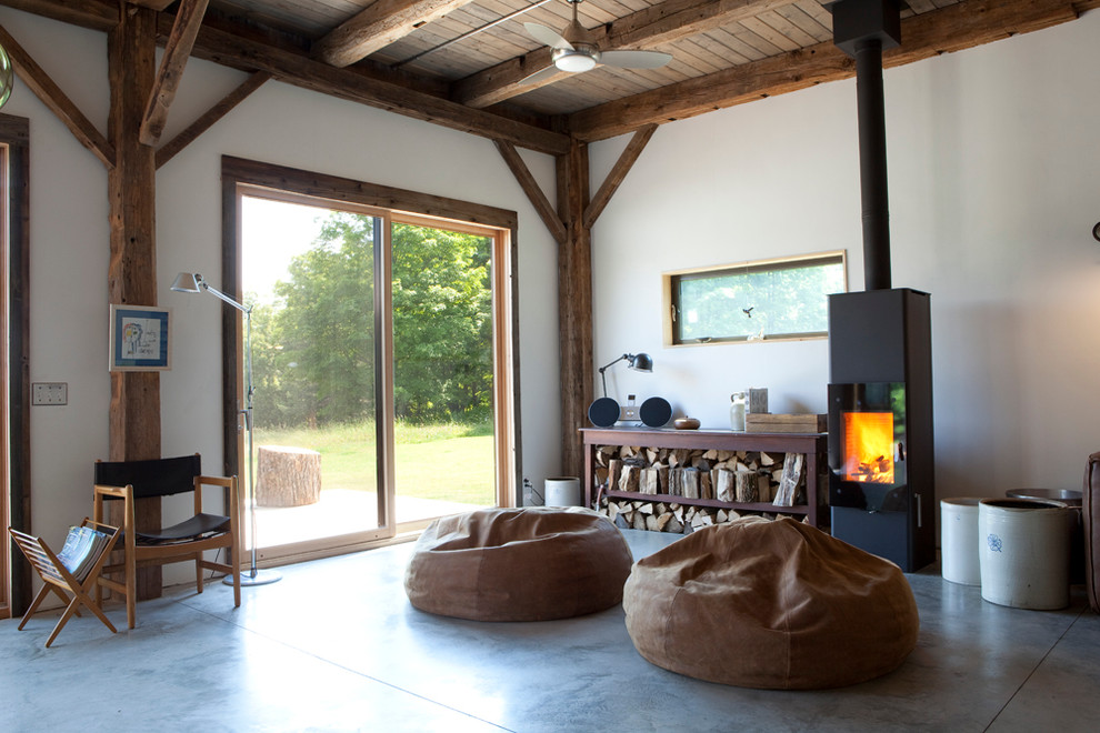Real Flame Gel Fuel Living Room Rustic with Bean Bag Chairs Cabin Ceiling Fan Concrete Flooring Exposed Beams Firewood Storage