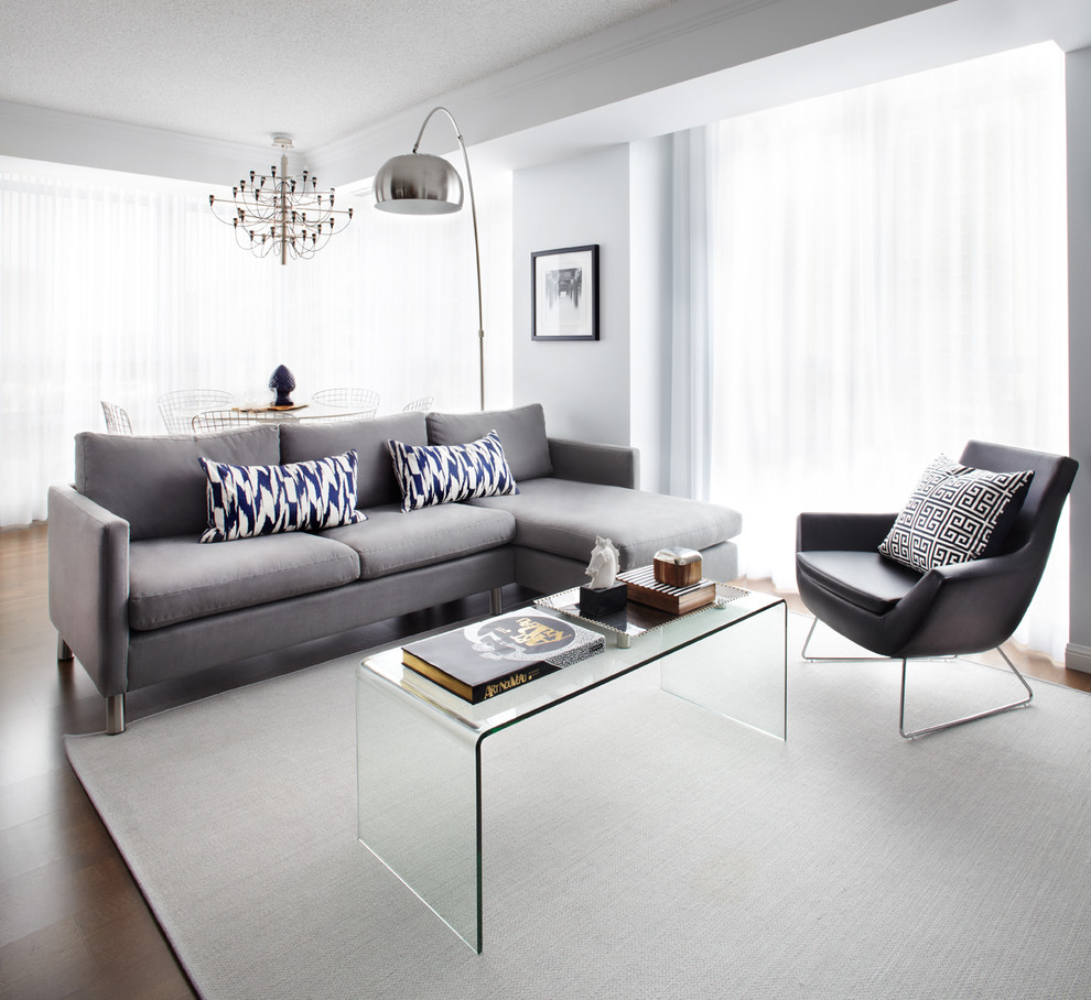 Reclining Couch Living Room Contemporary with Black Leather Blue Printed Pillows Glass Glass Coffee Table Glass Table Grey