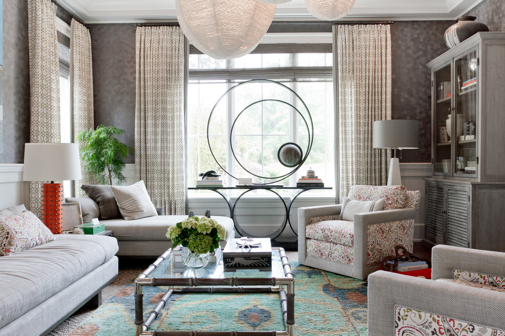 Reclining Loveseat with Console Living Room Contemporary with Artwork Carpeting Coffee Table Curtain Panels Elegant Frame and Panel Millwork Gray