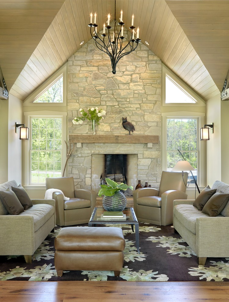Reclining Loveseat with Console Living Room Traditional with Area Rug Chandelier Fireplace Fireplace Mantel Lanterns Leather Armchair Leather Ottoman Neutral