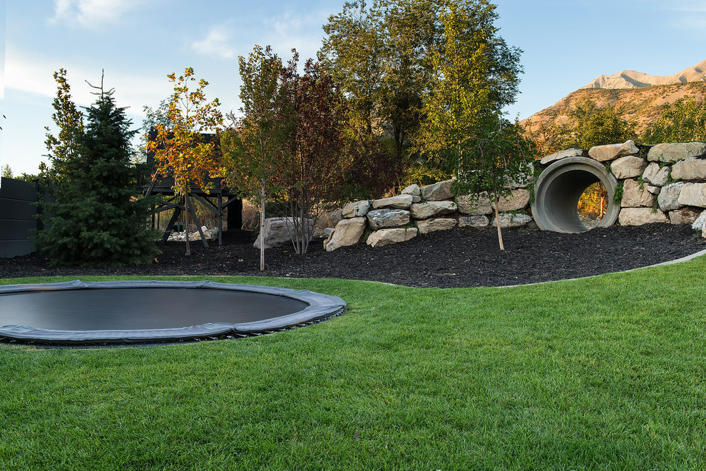 rectangle trampoline Landscape Contemporary with backyard bark mulch boulders drain pipe grass in ground trampoline lawn play