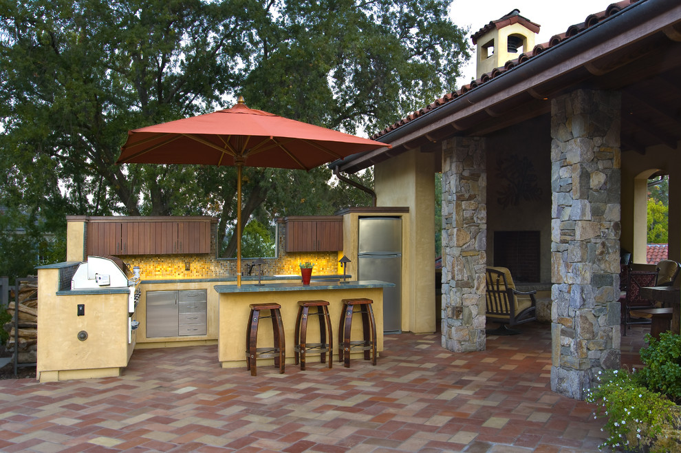 Rectangular Patio Umbrella Patio Mediterranean with Counter Stools Covered Patio Outdoor Kitchen Stainless Steel Stone Posts Stucco Tile