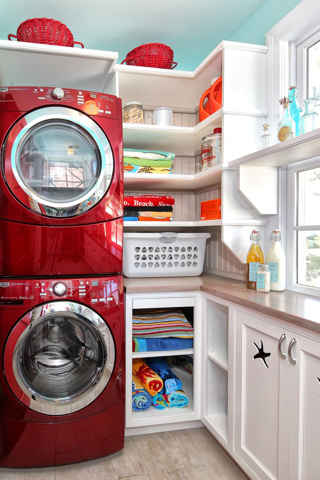 red sox sweatshirt Laundry Room Traditional with beach house beadboard built-in shelves front loading washer and dryer fun mud