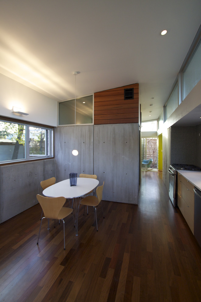 Reebok Elliptical Dining Room Contemporary with Cast Concrete Walls Ceiling Light Chair Clerestory Windows Concrete Concrete Wall Dining