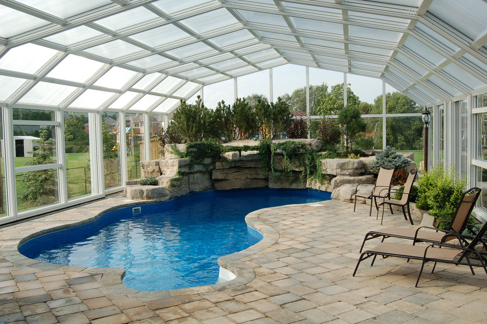 Retractable Garden Hose Pool Traditional with Boulder Wall Brick Patio Covered Pool Glass Ceiling Glass Wall Indoor Pool