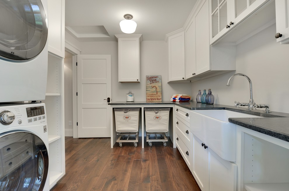 rolling laundry cart Laundry Room Transitional with apron sink bar faucet black hardware cup pulls dark counter farm sink