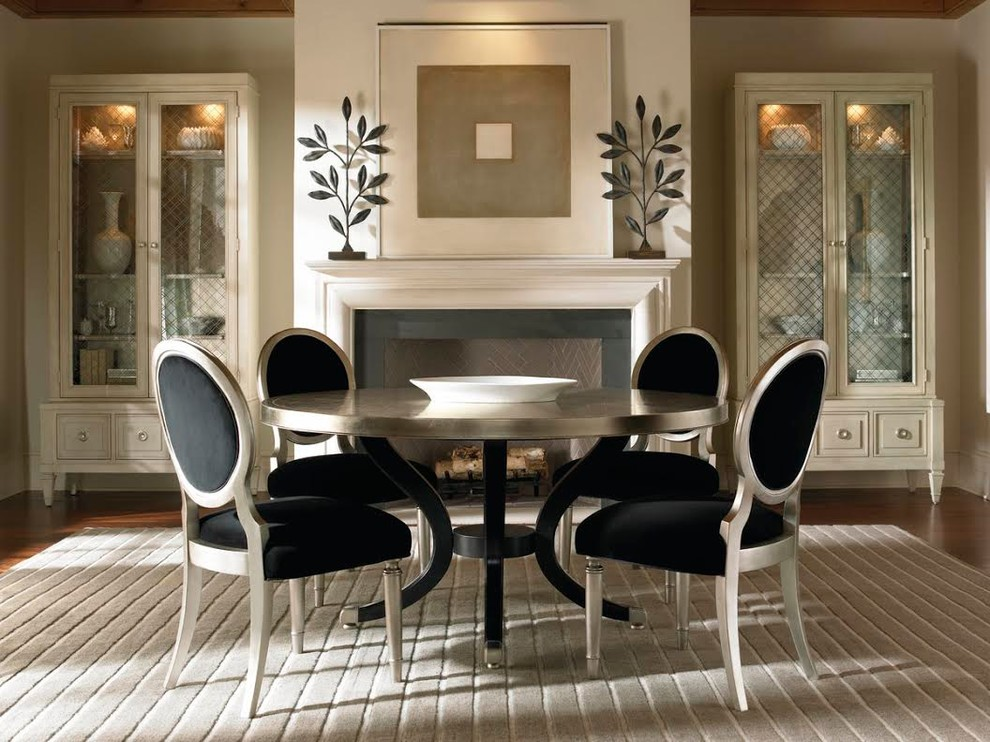 Round Dining Table with Leaf Dining Room Transitional with Area Rug Black Accents Black Chairs Chairs Dishes Display Display Cabinet Fireplace