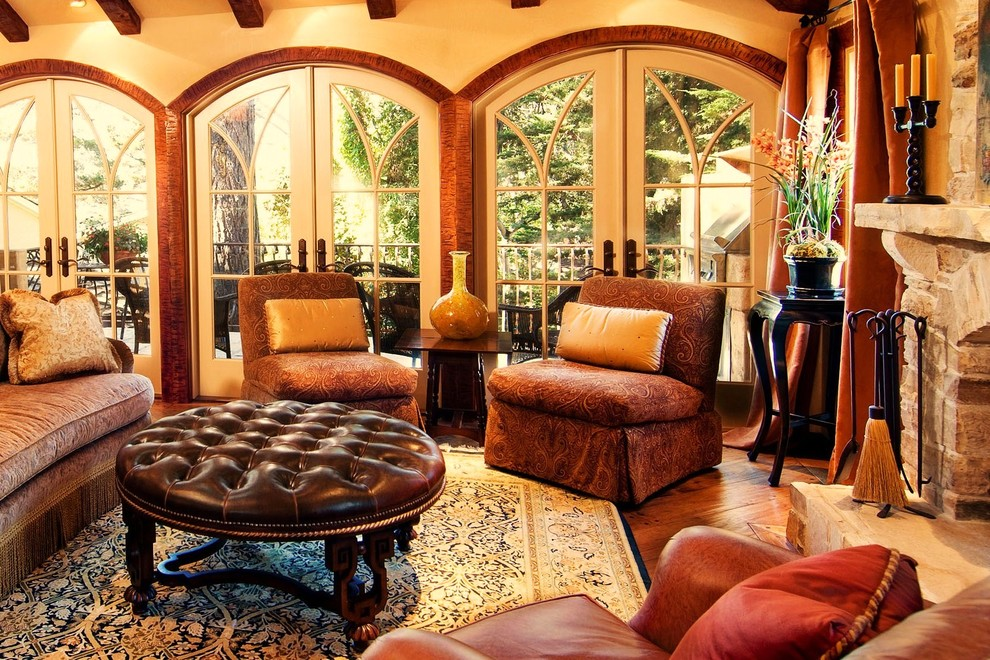 Round Leather Ottoman Living Room Rustic with Arched Windows Area Rug Chenille Sofa Container Plants Decorative Pillows Exposed Beams