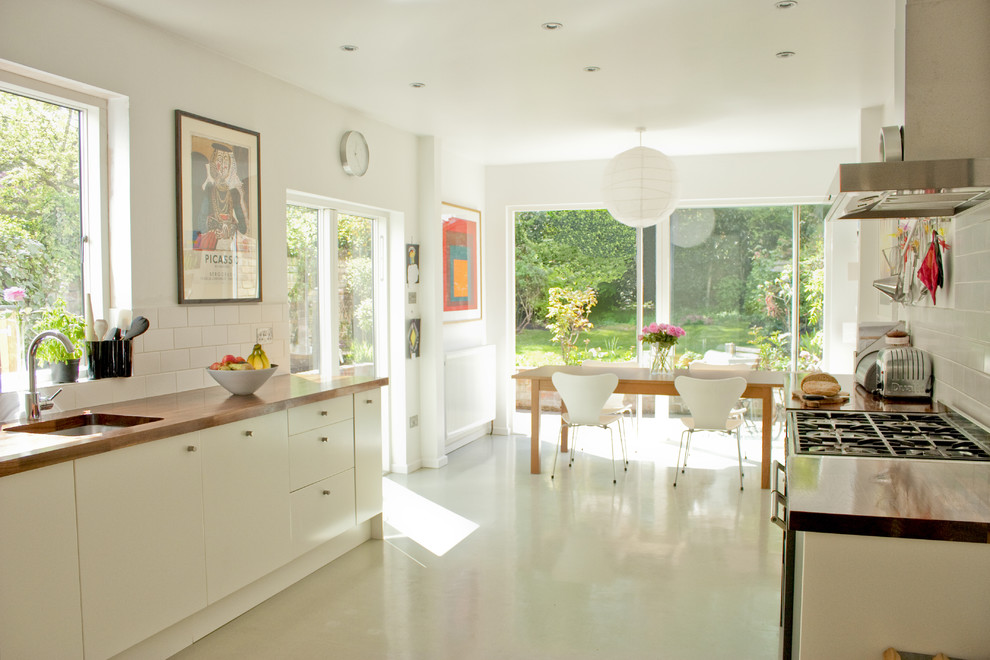rubber backed rugs Kitchen Contemporary with eat in kitchen Fritz Hansen chairs hood metro tile moulded plywood chairs