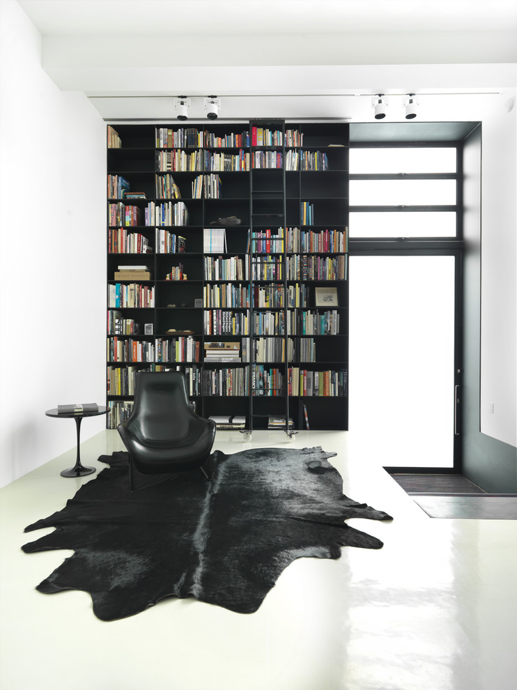 Rubber Backed Rugs Living Room Contemporary with Area Rug Black Black and White Bookcase Bookshelves Ceiling Lighting Cowhide Rug