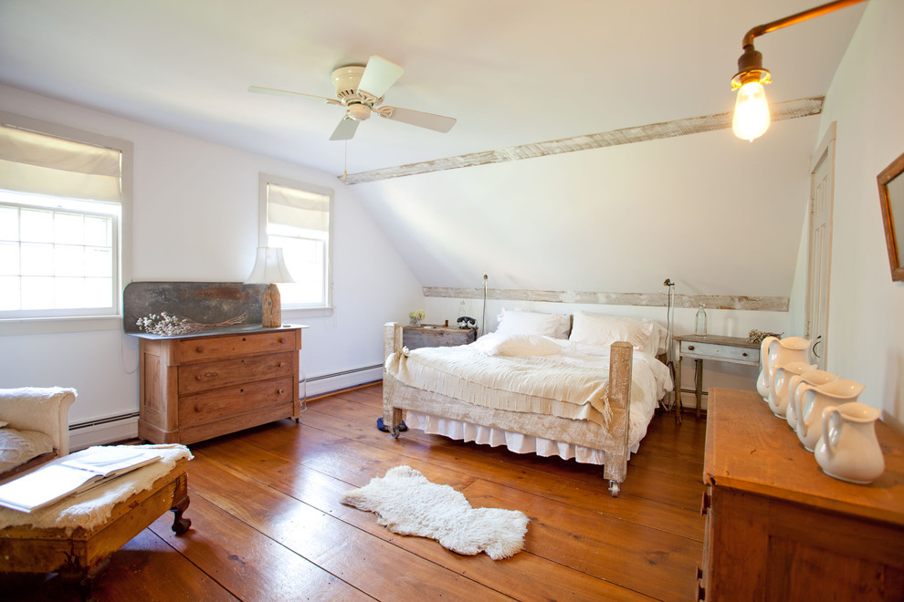 Rustic Bed Frames Bedroom Farmhouse with Armchair Ceiling Fan Chest of Drawers Neutral Colors Ottoman Rug Side Tables